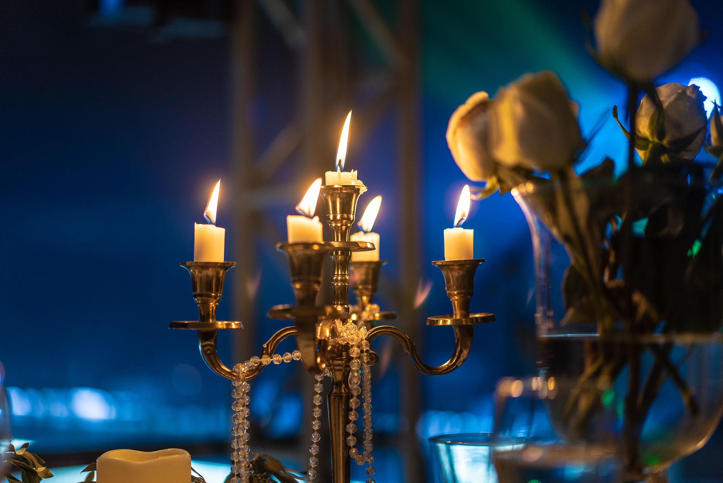 Candles burning near roses