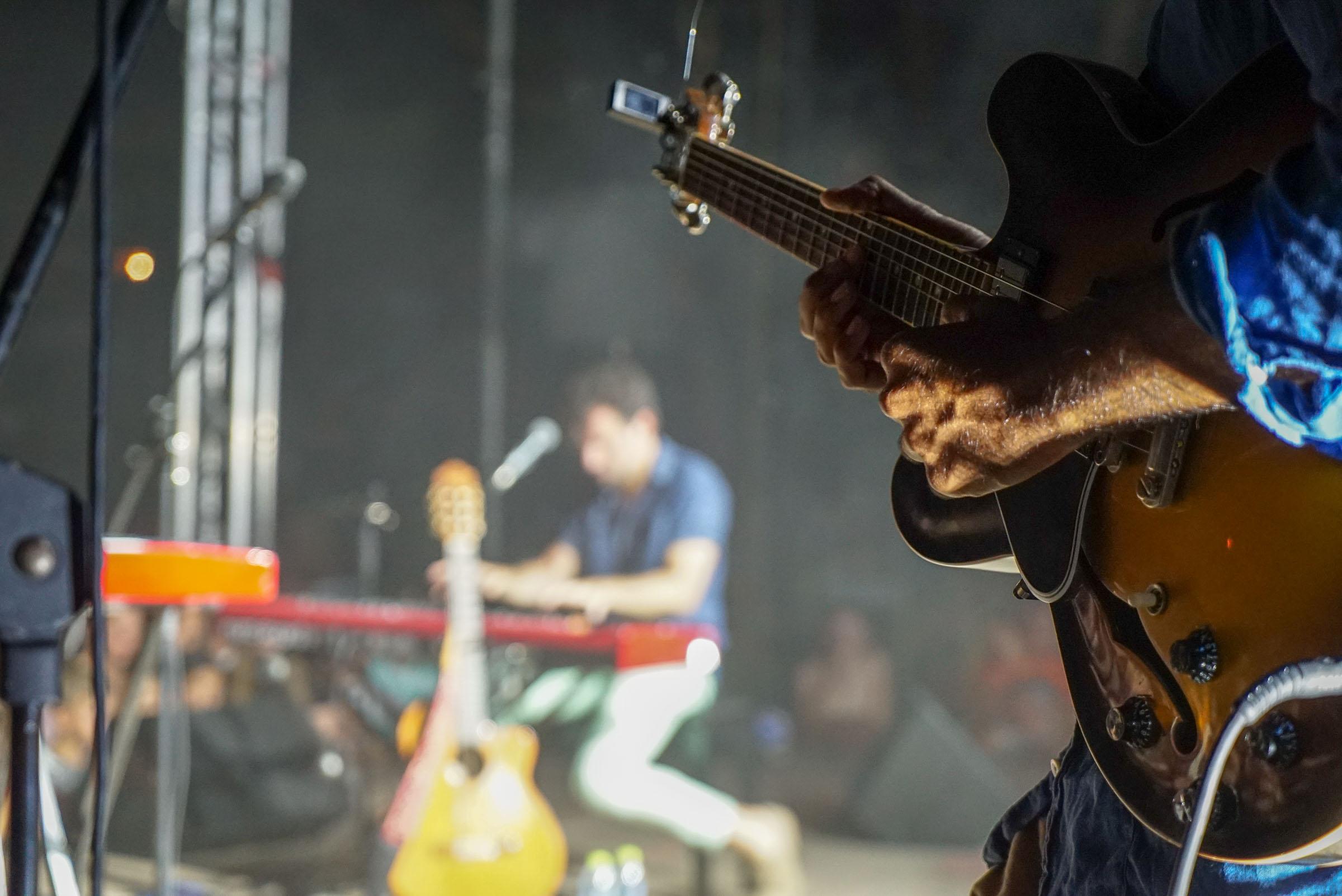 man palying guitar